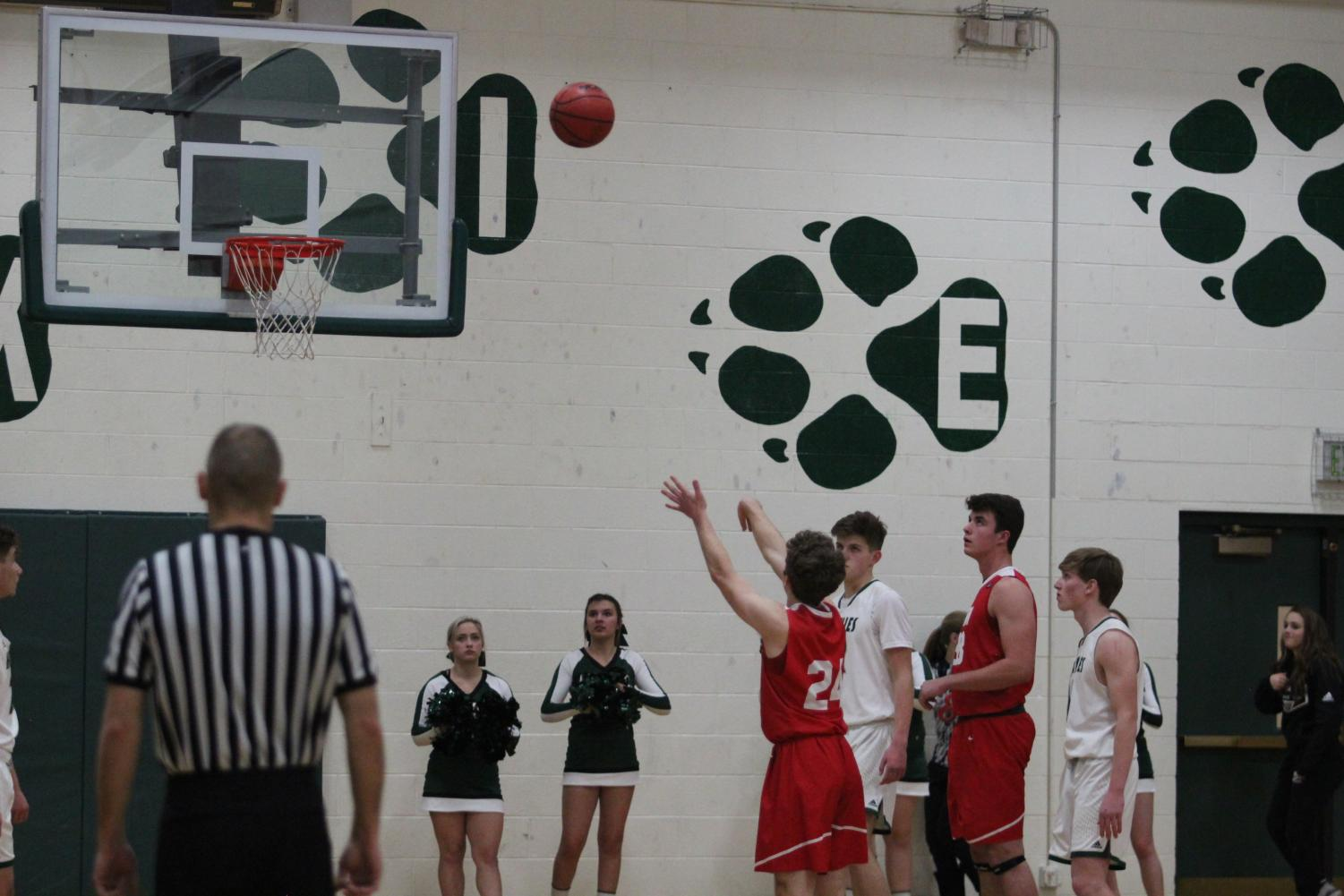 Nic Inda (20) shoots a successful free-throw during the third quarter