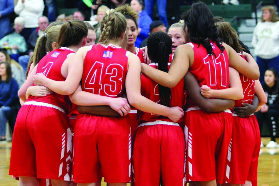 Girls+Basketball+huddles+up+before+the+game+as+they+prepare+to+play.++While+Coach+Todd+Hernandez+gets+his+team+ready+to+take+on+the+Huskies+