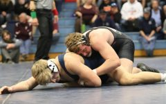 Reds Sending 8 Wrestlers to State After Taking Second at Regionals