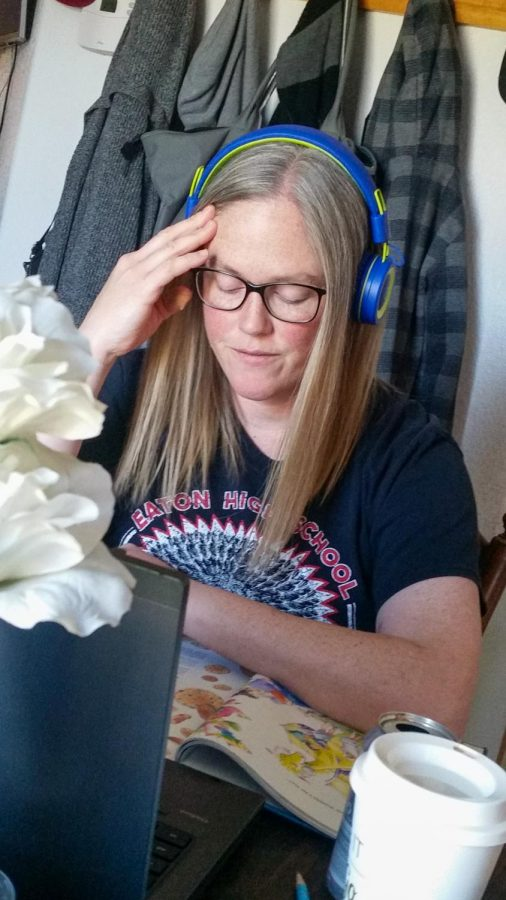 Tiffany+Schreiner+wears+her+son%27s+head+phones+in+order+to+give+her+students+her+undivided++attention.