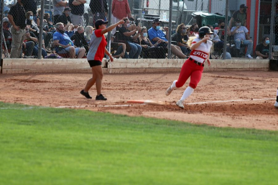 Brooke Beacom (22) rounds first and moves to second after smacking a double.