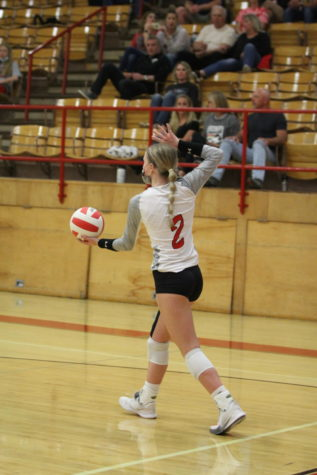 Rylee Martin (23) prepares to serve.