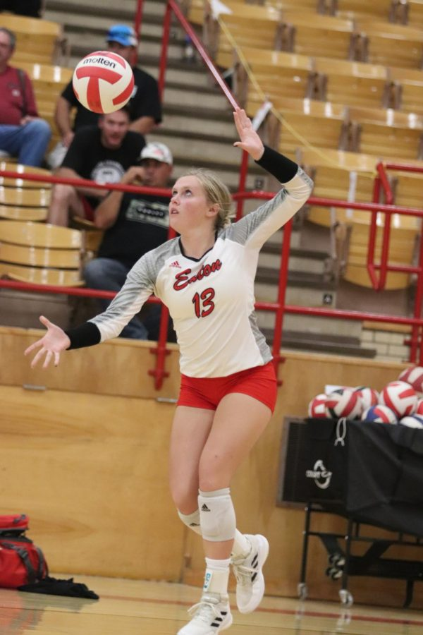 Megan St. Jean (22) tosses the ball up as she serves.