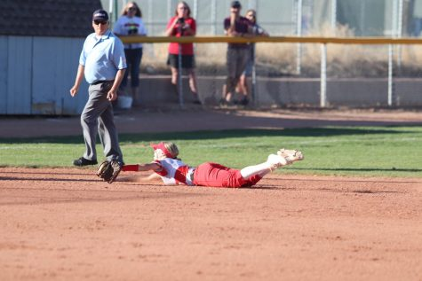 Blake Duncan(23) makes a diving stop on a ball up the middle.
