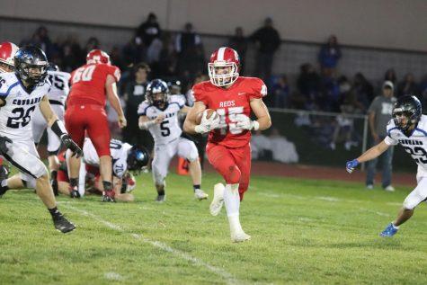 Ryan Dirksen (22) running the ball